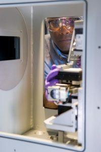 professor working with machine