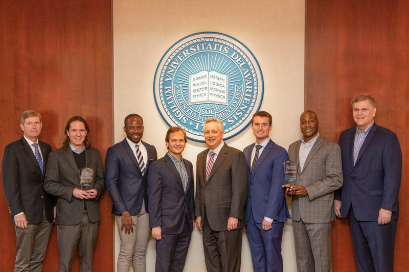 Celebrating the FastPass awards are (from left) Charlie Riordan, UD vice president for research, scholarship and innovation; Matt Hudson, assistant professor of Kinesiology and Applied Physiology; Elvis Ebikade, graduate student; Eric Gottlieb, postdoctoral researcher; UD President Dennis Assanis; Robert O'Dea, graduate student; Thomas H. Epps, III, Thomas and Kipp Gutshall Professor of Chemical and Biomolecular Engineering; and Bill Provine, president and CEO of Delaware Innovation Space.